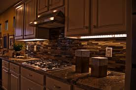 rustic kitchen area with string puck led under counter lights