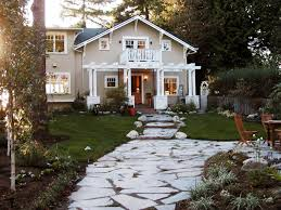 a flagstone pathway leads to a lovely two story craftsman house