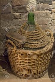 large oversized wine bottle in basket stock photo picture and