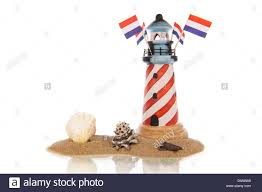 assorted seashells striped lighthouse with flags and assorted seashells in