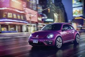 beetle volkswagen pink in photos vw shows new beetle concepts including one painted pink