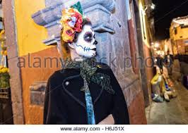 catrina costume a mexican woman dressed in a catrina costume with paint