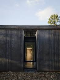 nature drove the design of this sculptural cor ten steel house in