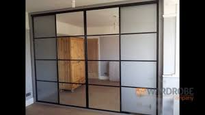 built in sliding door wardrobe pure white glass black frame