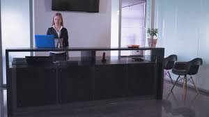 business greeting friendly smiling hotel receptionist greeting hotel guest stock