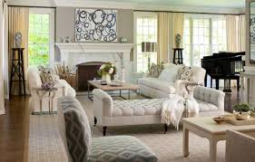 beautiful white tufted chaise lounge also white fireplace as well