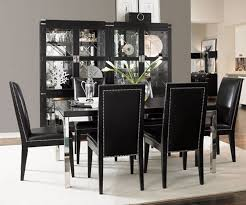 simple dining room with black table and black chairs with whiterug