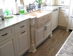 kitchen base cabinets legs the cabinetry is antique white paint by the sink