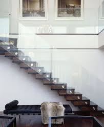i like the style of these glass stair railing kitchen ideas