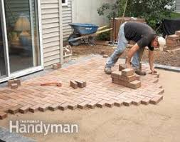 How To Lay Pavers For Patio How To Cover A Concrete Patio With Pavers Family Handyman