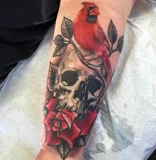 triple aaa halloween horror nights my first tattoo cardinal skull rose by urban aaa tattoo and
