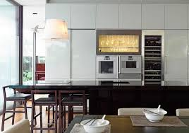 cool white kitchen refrigerator set before black kitchen island