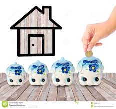 money saving with piggy bank and home icon stock photo image