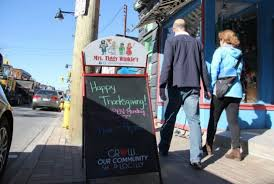 busy streets in the glebe as shops stay open on monday