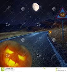 halloween night background on the road royalty free stock