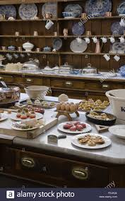 table in the kitchen laden with utensils and pastries with the