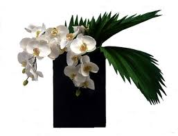 faux orchids faux white orchid and split leaf philodendron