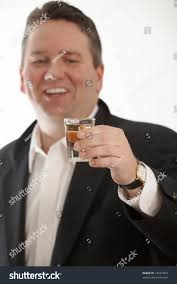 man holding martini drunk business man toasting dof focus stock photo 13527004