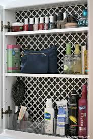 cleaning organizing bathroom with pedestal sink medicine cabinet