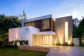 well turned cool modern house with fresh grass near plants on