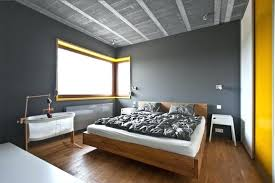 bed and living yellow and gray room