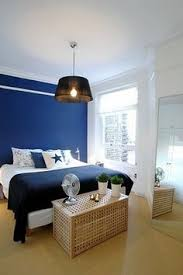 A Monochromatic Decorating Scheme Is Designed All Around One Color - Blue and white bedroom designs