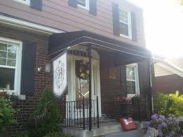 Wooden Window Awnings Fancy Design Ideas Using Rectangular Black Iron Hand Rails And
