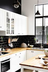 white kitchen cupboards black bench 7 great ideas for a black and white kitchen home beautiful