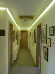 lighting ideas led strip lights on top of the wall for hallway