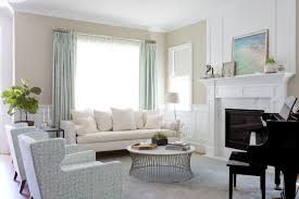 piano in living room white and blue living room with piano transitional living room