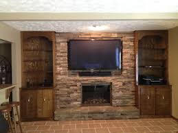 tv mounted new stone face and rock fp door and stone facing
