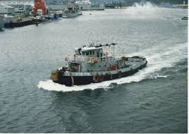 tug boat used to push or pull ships away from or against the pier