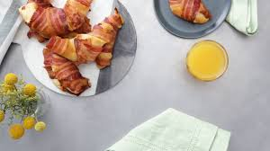 bacon wrapped breakfast croissant recipe tastemade