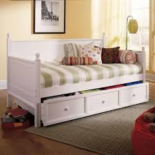 white wooden daybed with drawers and soft green white striped bed