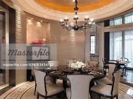circular dining room circular dining table in elegant dining room stock photo
