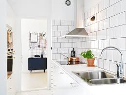 subway tile kitchen dark grout l shape modern white cabinet open