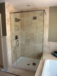 bathroom glass frameless shower doors matched with tan wall plus
