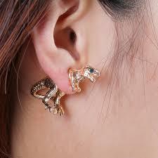 t rex earrings gold 2 t rex stud earrings gold piercing and metallic