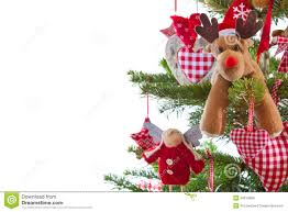 christmas tree with red and white hanging decoration with elk on