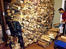 stacking firewood the country stove and patio lifestyle
