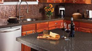 best kitchen counter material with elegant brown mosaic backsplash