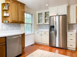painting my oak kitchen cabinets white updating wood kitchen cabinets remodeled