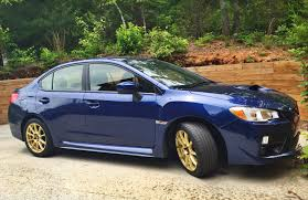 blue subaru gold rims runlite konig wheels