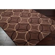 these durable brown geometric rugs bring the modern colors of