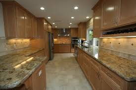 maple cabinets travertine backsplash granite counter and