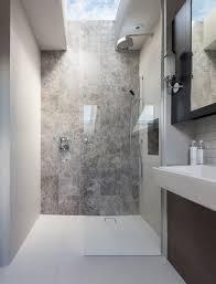 peek architecture design walk in shower stone feature wall