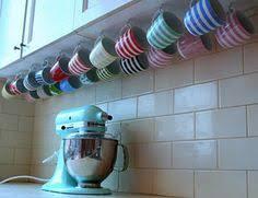 under cabinet coffee mug rack long scrap of wood 1 2 dowels drill with 1 2 bit glue