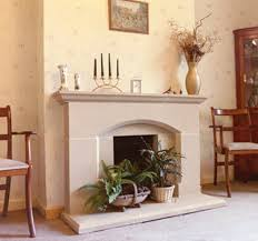 decorate fireplace mantel with flowers and candle stixck decor crave
