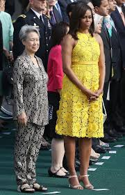 michelle obama wears yellow sleeveless dress at white house