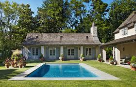 Traditional Home Style A French Style Guesthouse Sits At The End Of A Sparkling Pool